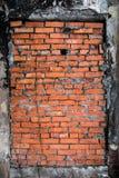 La ventana del bricked-up de un edificio abandonado Imagenes de archivo