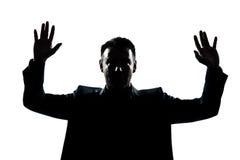 La verticale d'homme de silhouette remet vers le haut Photo stock