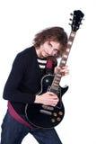 La verticale d'un homme avec la guitare apprécient la musique Photo libre de droits