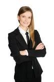 La verticale d'un milieu heureux et réussi a vieilli le cadre d'affaires féminin avec les bras croisés sur le fond blanc de la fem Image libre de droits