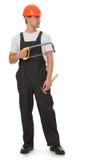 La verticale d'un ouvrier semble est Images libres de droits