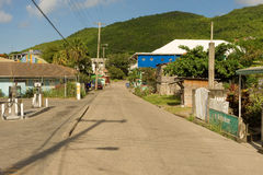 La via principale di piccola isola dei Caraibi Immagine Stock Libera da Diritti