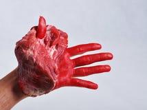 La viande a porté dedans une main Images libres de droits