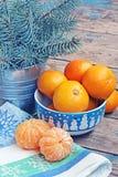 La vida todavía del Año Nuevo con las mandarinas y el abeto ramifica Imagen de archivo