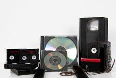 La videocassetta di stoccaggio di media lega il dvd con un nastro millimetro del CD Immagine Stock