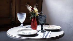 La vie d'un vintage dénommait toujours la table de dîner photo stock