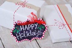 La vie toujours avec bonnes fêtes le signe et les boîtes actuelles Photo libre de droits