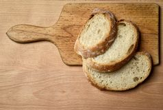 La vie toujours avec du pain coupé en tranches Photographie stock libre de droits