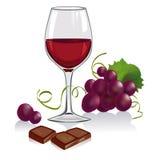 La vie toujours avec un verre de vin, de raisins et de chocol Image libre de droits