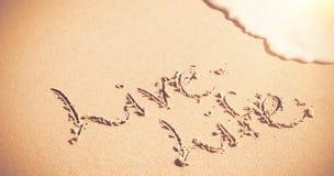 La vie vivante écrite sur le sable Images stock