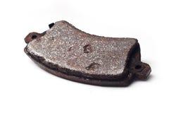 La vieille garniture de frein rouillée a isolé Photographie stock