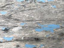 La vieille table en bois bleue avec beaucoup raye et fend Photos libres de droits