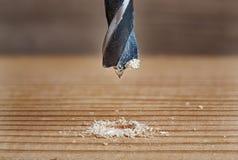 La vieja broca del metal hace el agujero en la madera Imágenes de archivo libres de regalías