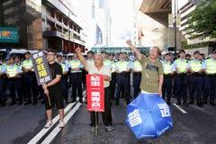 La visite du Chef chinois suscite des protestations dans H.K. Images stock