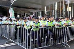La visite du Chef chinois suscite des protestations dans H.K. Photos stock