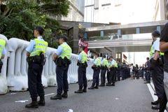 La visite du Chef chinois suscite des protestations dans H.K. Photos libres de droits