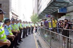 La visite du Chef chinois suscite des protestations dans H.K. Photographie stock libre de droits