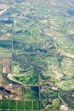 La vista aerea del raccolto della terra dell'azienda agricola sistema negli S.U.A. Fotografie Stock