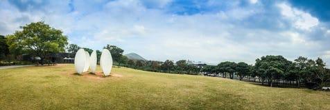La vista all'aperto del giardino del campo di erba del museo del tè di Osulloc in panora Immagine Stock