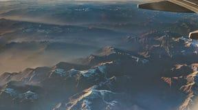 La vista delle alpi in Austria da un aeroplano Immagine Stock