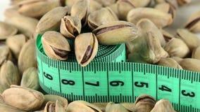 La vista di macro di misura e del pistacchio video d archivio