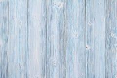 La vista superior o la endecha plana de tablones de madera azules, papel pintado rústico con el espacio de la copia, alista para  Foto de archivo