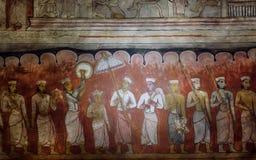 La vita della persona reale ed i suoi servi sull'affresco antico del I secolo BC scavano il tempio di Buddha fotografia stock
