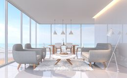 La vita e la sala da pranzo bianche moderne con il mare osservano l'immagine della rappresentazione 3d C'è grande finestra trascu Fotografie Stock