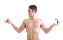 La vitamina o la compressa di resistenza delle pillole inscatola l'uomo di supplementi isolato Fotografia Stock