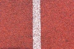 La voie courante folâtre la texture Cache en caoutchouc de piste courante Le matériel de voie de tartan est le sur synthétique to image libre de droits