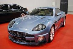 La voiture avantageuse d'Aston Martin DB7 avec l'accord de Mansory dans l'expo 2012 de crocus Photos stock