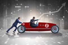 La voiture d'homme d'affaires enfonçant le concept de travail d'équipe Photo stock