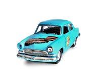 La voiture de jouet sur un fond blanc Images stock