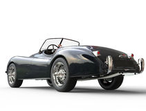 La voiture noire de vintage a tiré sur le fond blanc - vue arrière Photos stock