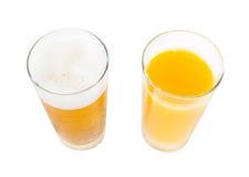 La vostra scelta: birra o succo Fotografie Stock Libere da Diritti