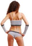 La vue arrière de la fille crépue dans le point de polka vêtx. photographie stock libre de droits