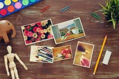 La vue supérieure de l'art d'artiste assure le fond à côté du collage de cadres de photo Copiez l'espace Photo stock