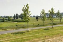La vue sur un terrain de golf scénique néerlandais, au milieu des Pays-Bas, a appelé le cerf de Groene photo libre de droits