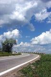 La vuelta de la carretera del país Imagen de archivo libre de regalías