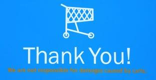 La vuelta del carro de compras le agradece firmar Foto de archivo libre de regalías