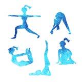 La yoga plantea iconos de las siluetas Foto de archivo
