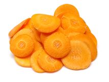 La zanahoria corta la naranja Fotos de archivo