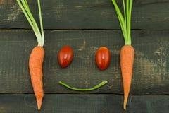 La zanahoria y el tomate frescos Fotografía de archivo libre de regalías