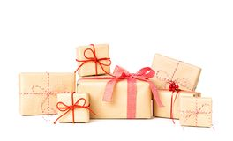 Laarge Stack of Gift box wrapped in recycled paper with ribbon bow stock photography