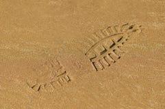 Laarsvoetafdruk op nat zand Stock Fotografie