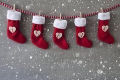 Laarzen als Advent Calendar, Cement, Nicholas Day, Sneeuwvlokken Stock Fotografie