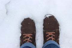 Laarzen in de sneeuw Stock Foto