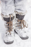 Laarzen in de sneeuw Stock Foto's