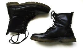 Laarzen die bovenkant proberen - neer Stock Afbeelding