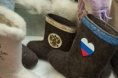 Laarzen met de Russische symbolen van de staat Stock Foto's